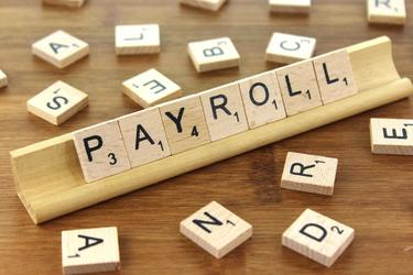 Payroll Taxes, Monthly Deposit Schedule Vs. Semi-weekly Deposit Schedule